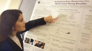 Hawazin Aljehani presenting her poster, MS, SLP Ambulatory Voice Monitoring of a Muslim Imam During Ramadan